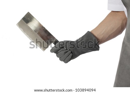 a gloved hand holds a sharp knife isolated on white with room for your text or images #103894094