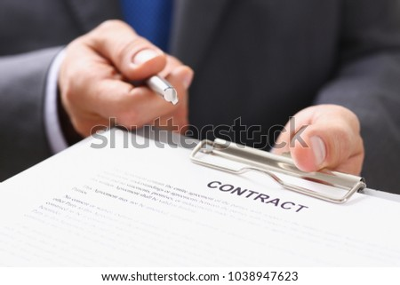 Male arm in suit offer contract form on #1038947623