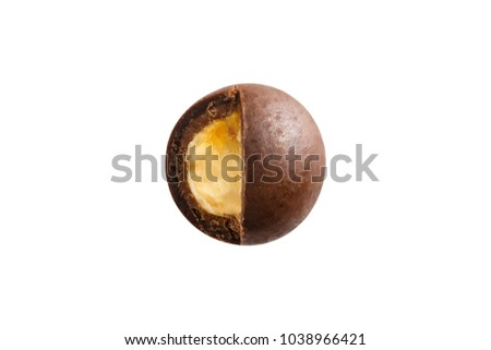 Sugared hazelnut dragees in chocolate isolated on white background. Chocolate balls candy filled with nut Royalty-Free Stock Photo #1038966421