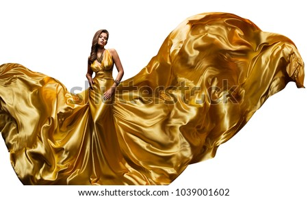 Fashion Model Golden Fly Dress, Elegant  Woman in Fluttering Gold Gown, Beautiful Girl and Silk Fabric Fly, Isolated on White Background #1039001602