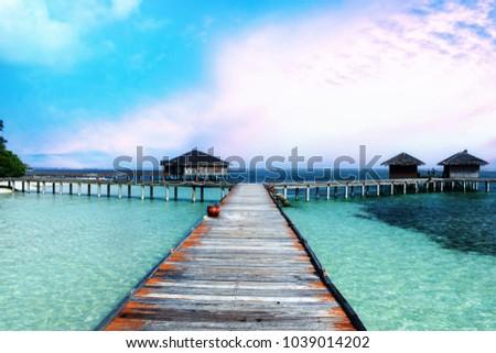 Beautiful tropical Water Villas at Maldives beach resort hotel for holiday background #1039014202