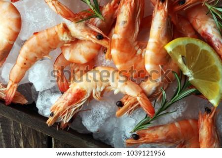 Raw fresh Prawns Langostino Austral. shrimp seafood with lemon and spices #1039121956