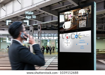 Intelligent Digital Signage , Augmented reality marketing and face recognition concept. Interactive artificial intelligence digital advertisement navigator direction for retail coffee shop. Royalty-Free Stock Photo #1039152688