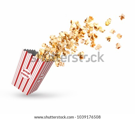Popcorn poured from a paper cup #1039176508