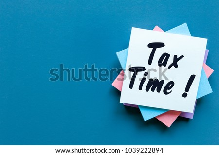 Tax time - Notification of the need to file tax returns, tax form at accauntant workplace with empty space for text, mockup or template #1039222894