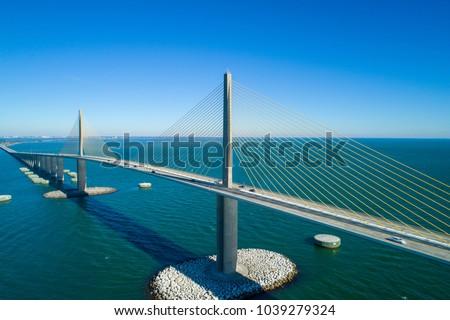 Aerial image of a steel cable suspension bridge Tampa Bay Florida #1039279324