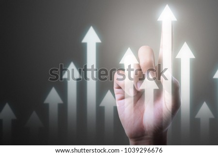 Businessman plan graph growth and increase of chart positive indicators in his business #1039296676