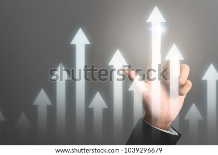 Businessman plan graph growth and increase of chart positive indicators in his business #1039296679