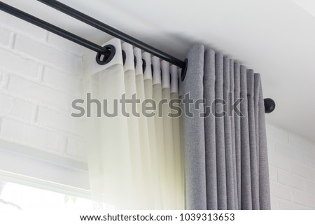 The white curtains with ring-top rail, Curtain interior decoration in living room Royalty-Free Stock Photo #1039313653