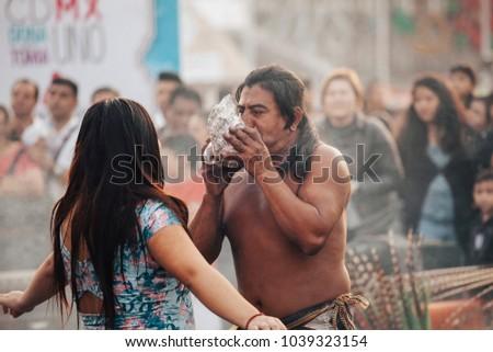 MexicoCity, Mexico - Decembre 22, 2017: traditional Aztec shaman in the capital city of Mexico, DF, Mexico. #1039323154