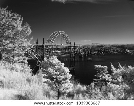 black and white image of a bridge in Newport, Oregon taken with a camera that was altered to take images in infrared light #1039383667