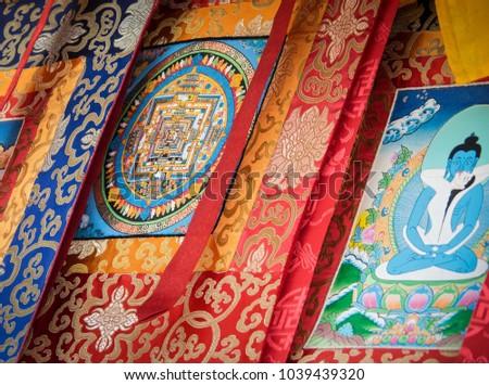 Tibetan Styled Hanging Fabrics By Indian Street Vendor #1039439320