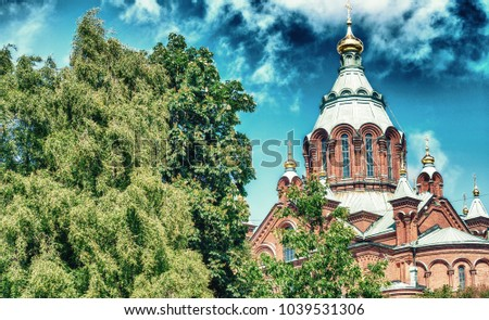 Uspenski Cathedral andcity trees in summer season, Helsinki. #1039531306