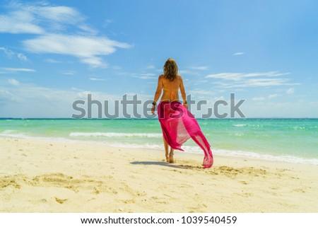 Woman at the beach in Koh Poda island #1039540459
