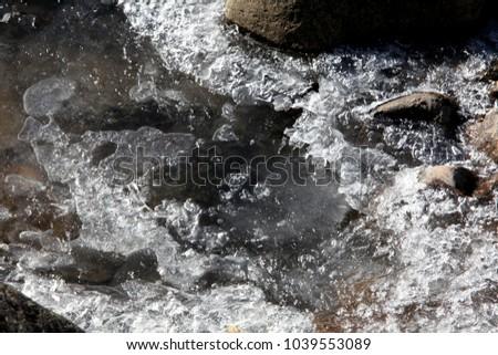 beautiful patterns of frozen ice on rivers #1039553089