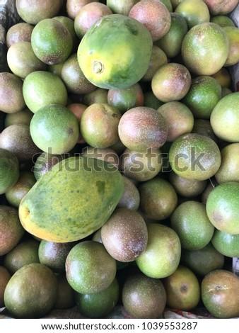 Tropical Fruits: Papaya and Passion Fruit  #1039553287