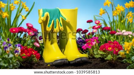 Gardening tool and flower in garden #1039585813