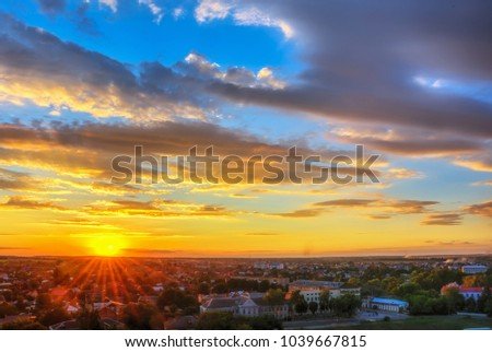 Sky with clouds over city at splendid sunset. #1039667815