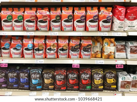 Spencer, Wisconsin, March,5, 2018   Several brands of Coffee on a modern Grocery Store shelf #1039668421