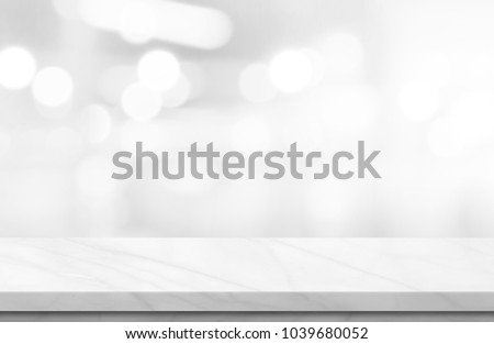 Empty white marble over blur background, for your photo montage or product display, Space for placing items on the table, product and food display. #1039680052