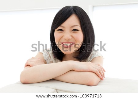 Beautiful young woman relaxing living room. Portrait of asian. #103971713