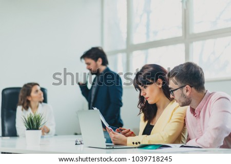 Colleagues working at office in front of computer #1039718245