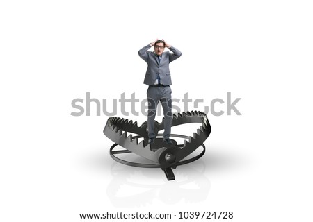Man caught in mouse trap in risk business concept  Royalty-Free Stock Photo #1039724728