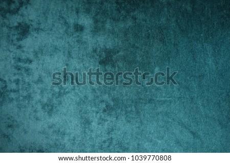 Dark green velvet fabric surface from above #1039770808
