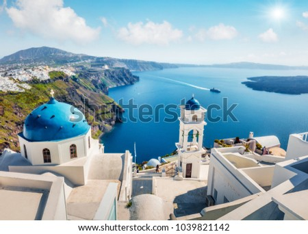 Sunny morning view of Santorini island. Picturesque spring scene of the  famous Greek resort Fira, Greece, Europe. Traveling concept background. Orton Effect.