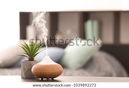 Aroma lamp on table Royalty-Free Stock Photo #1039892272
