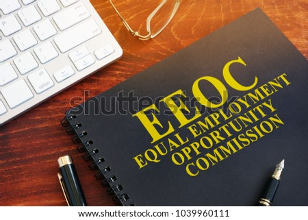 Equal Employment Opportunity Commission EEOC on a desk. #1039960111