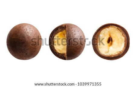 Sugared hazelnut dragees in chocolate isolated on white background. Chocolate balls candy filled with nut Royalty-Free Stock Photo #1039971355
