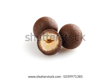 Heap of sugared hazelnuts dragees in chocolate isolated on white background. Handmade chocolate balls candies filled with nuts Royalty-Free Stock Photo #1039971385