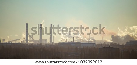 Smoke from the pipes of an industrial plant in the morning #1039999012