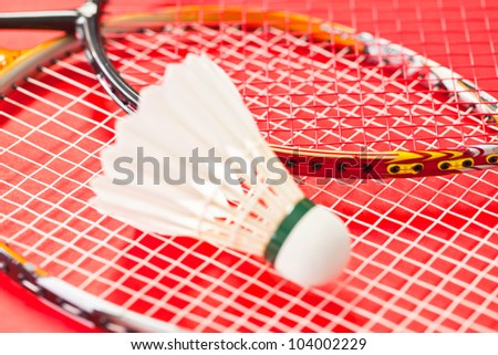 a racket and shuttlecock on red #104002229