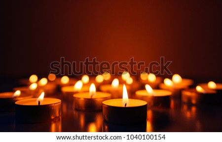 Kemerovo, Russia, fire in the mall, burning candles. Shallow depth of field. Many candles burning at night. Abstract candles background. Many candle flames glowing on dark background. Close-up. Free s #1040100154