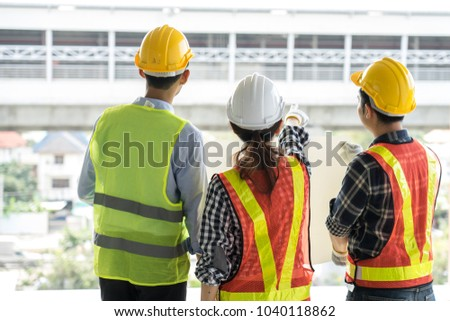 engineers visit the construction site.Examining blueprint with construction manager. #1040118862