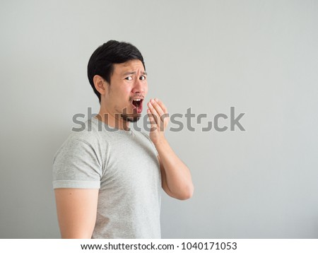 Funny face of bad breath Asian man. #1040171053