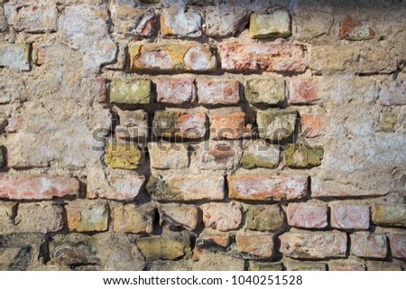 The wall of an old brick house. Background, texture, building. #1040251528
