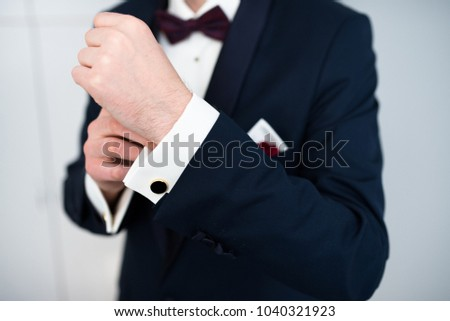man wearing elegant clothes - suit,   Shirt and fashionable, elegant bow-tie #1040321923
