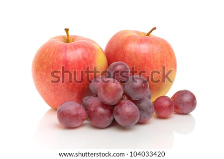 ripe red apples and grapes isolated on white close-up
