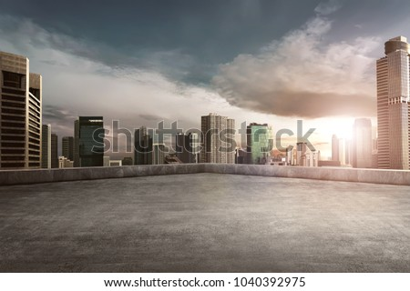 Rooftop balcony with cityscape at sunset #1040392975