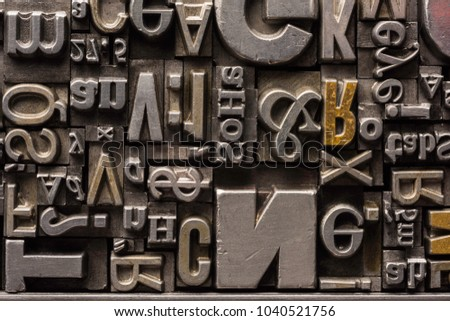 Metal Letterpress Types. A background from many historical typography letters in black and white with white background.  #1040521756