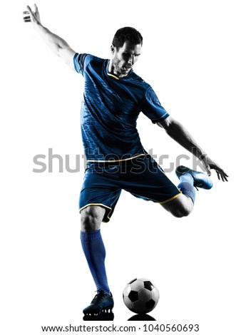 one caucasian soccer player man playing kicking in silhouette isolated on white background #1040560693