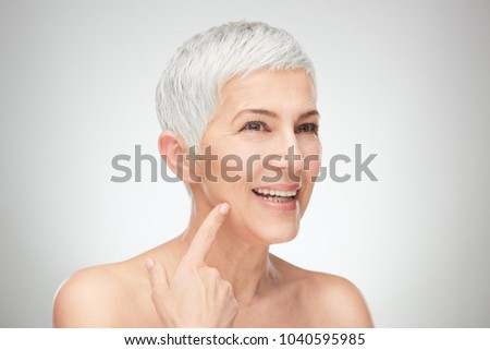 Head shot of senior woman showing wrinkles. #1040595985