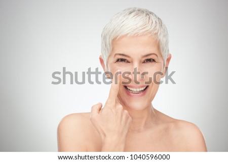 Head shot of senior woman showing wrinkles. #1040596000