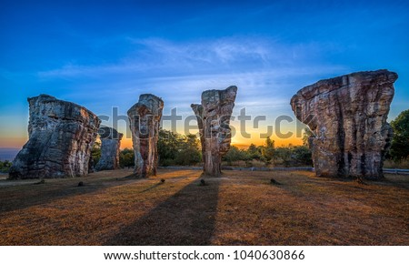 MOR HIN KHAOW, Chaiyaphum while sunrise or the Stonehenge of Thailand and unseen in Thailand. Due to the accumulation of silt and clay from water become rocks,this is amazing Thailand and environment. #1040630866