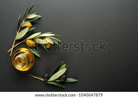 Olive oil and olive branch on black background #1040647879