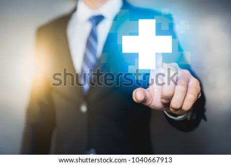 Businessman pushing button positive thing. Profit, Benefits Concepts.  #1040667913