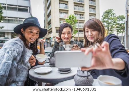 Three women doing shopping outdoors - Best friends meeting while shopping in Tokyo #1040691331